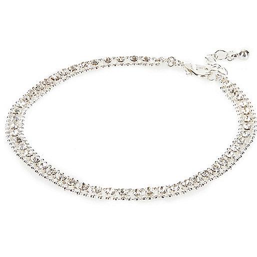 Bracelet de cheville argenté orné