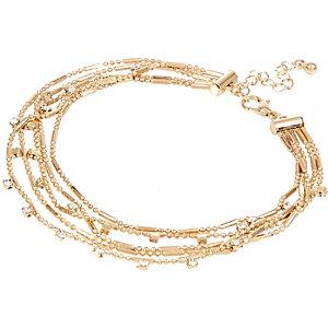 Gold tone embellished row anklet