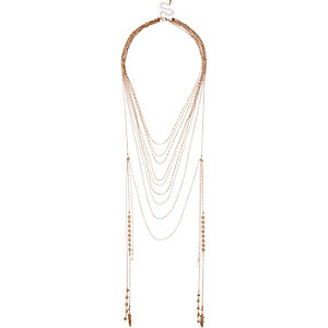 Gold tone draped chain necklace