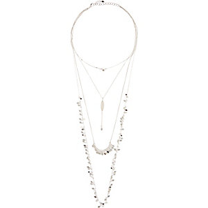 Silver tone long embellished necklace