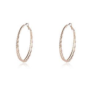 Gold tone ridged hoop earrings