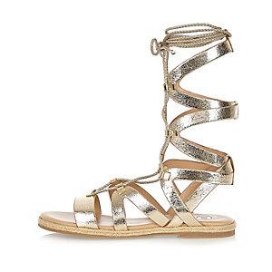 Metallic gold lace-up gladiator sandals