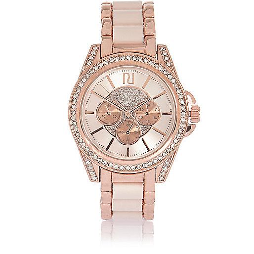 Grosse montre doré rosé ornée