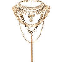 Gold tone crystal tassel back detail necklace