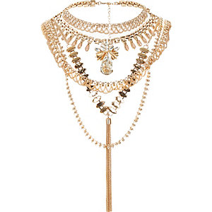 Gold tone crystal tassel back detail necklace