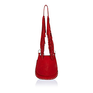 Red leather fringed saddle handbag