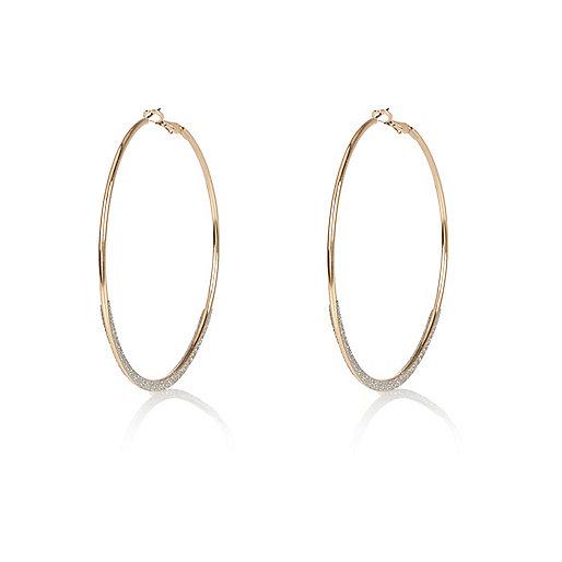 Gold tone glittery hoop earrings