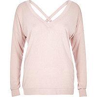 Light pink V-neck cross back sweater