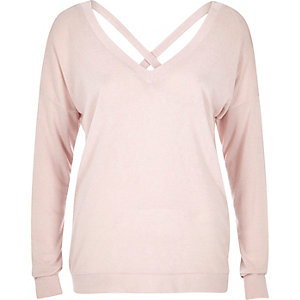 Light pink V-neck cross back sweater