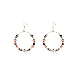 Gold tone bead and wood hoop earrings