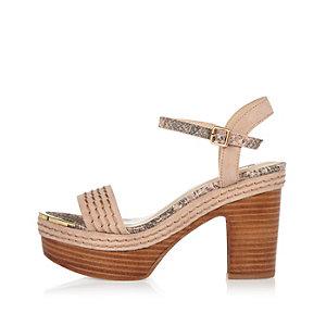 Pink wooden platform sandals