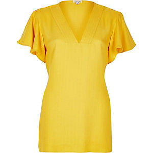 Yellow frilly sleeve top
