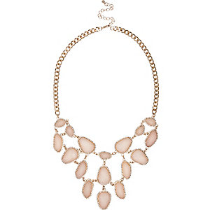 Gold tone pink stone statement necklace