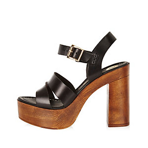 Black leather heeled platforms
