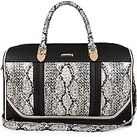 Black snake print laser cut weekend bag