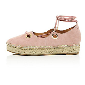 Pink eyelet lace-up espadrilles