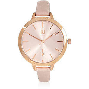 Gold tone nude strap watch