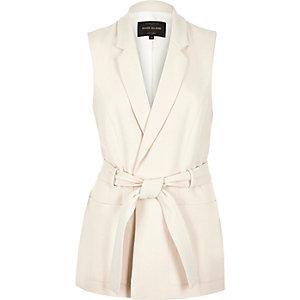 Cream belted sleeveless jacket