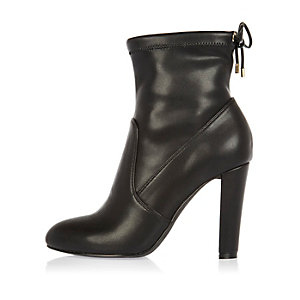Black tie back heeled ankle boots