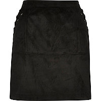 Mini-jupe en suédine noire avec surpiqûres
