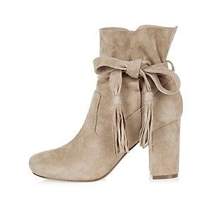 Beige suede tassel heeled ankle boots