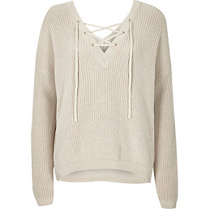 Cream knitted lace-up slouchy sweater