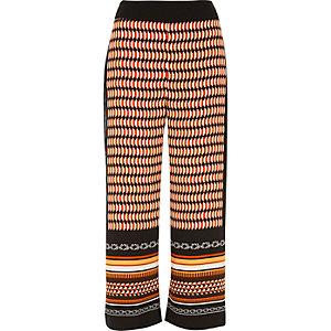 Orange print wide leg crop pants