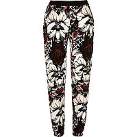 Black floral print jersey jogger pants