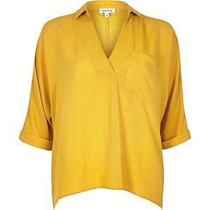 Yellow split back blouse