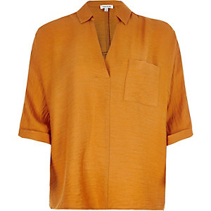 Orange split back blouse