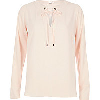 Light pink eyelet lace-up top
