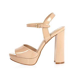 Nude patent platform sandals