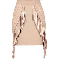 Light pink knitted fringed mini skirt