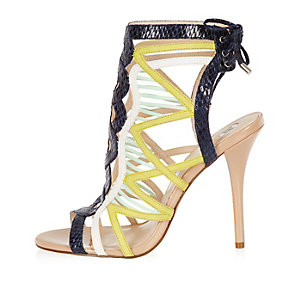 Yellow caged tie back heels