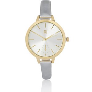 Gold tone metallic strap watch