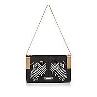 Black laser cut handbag