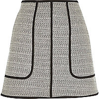 Black woven A-line mini skirt