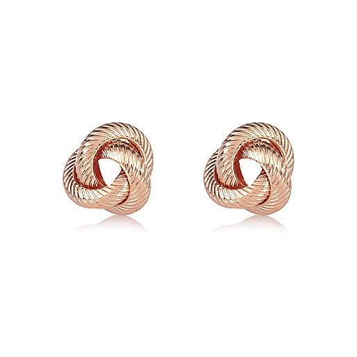 Clous d'oreilles façon or rose motif noué