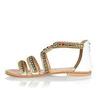 Sandales en cuir blanc ornées de perles
