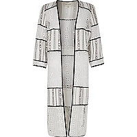 Kimono en dentelle blanche
