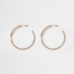 Rose gold tone twist hoop earrings