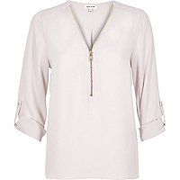 Light pink zip-up shirt