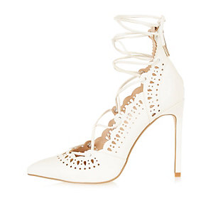 White laser cut lace-up heels