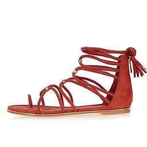 Orange gladiator sandals