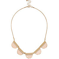 Gold tone pink half moon necklace
