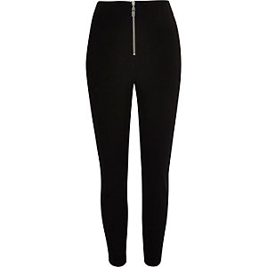 Black zip front skinny trousers