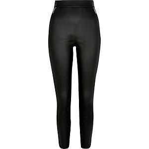 Black coated skinny trousers