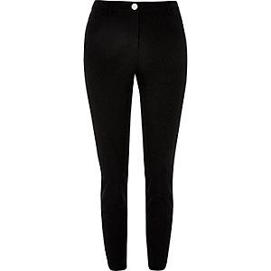 Black stretch skinny trousers