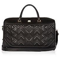 Black embroidered weekend bag