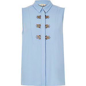 Light blue embellished sleeveless blouse